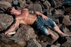 Male model on the rocks Stock Image