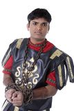 Male Model in Roman Soldier Costume. Adult Male Indian Model dressed as Roman Soldier over white background Royalty Free Stock Images