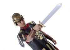 Male Model in Roman Soldier Costume. Adult Male Indian Model dressed as Roman Soldier over white background Stock Photography
