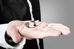 A male model showcasing cuff links in his hand Stock Photos