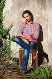 Male model sitting with legs crossed Stock Photography
