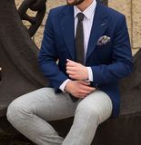 Male model. In a suit sitting on an anchor Royalty Free Stock Photography