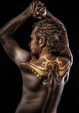 Male model with tribal tattoo, evil, blind, fallen angel of death. Helmet, Male model evil blind fallen angel stock image