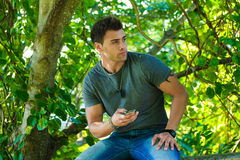 Male Model using a cell phone. Royalty Free Stock Photos