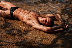 Male model in water Stock Photos
