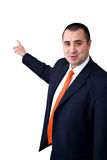 Male Model wearing a suit pointing to a white back. Ground Royalty Free Stock Photo