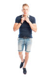 Male model wearing summer clothes fixing his collar Royalty Free Stock Photo