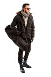 Male model wearing winter clothes and carrying a big bag Stock Images