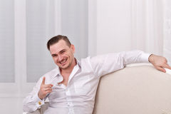 Male model in white shirt. Joking Stock Photography