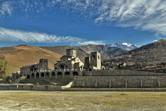 Male monastery. Nature view of the Caucasus Ossetia, Fiagdon gorge autumn mountain monastery rocks sky snow clouds trees Stock Photos