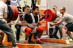 Male mongolian athlete powerlifting squat attempt Stock Photo