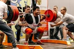 Male mongolian athlete powerlifting squat attempt. Chelyabinsk, Russia - July 15, 2017: male mongolian athlete powerlifting squat attempt during Сhampionship of Stock Photo