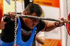 Male mongolian athlete preparing for powerlifting squat Royalty Free Stock Photos