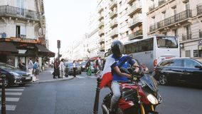 Male on motorcycle with French flag before major sport event stock video