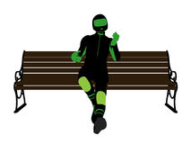 Male Motorcycle Rider on a bench Silhouette Royalty Free Stock Photos