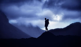 Male mountain climber standing on top of the hill Royalty Free Stock Photography