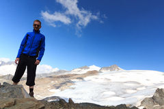 Male mountaineer and mountain glacier panorama with summit Grossvenediger south face in the Hohe Tauern Alps Stock Photo