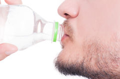 Male mouth drinking water. Close up with male mouth drinking water on white background Stock Photography