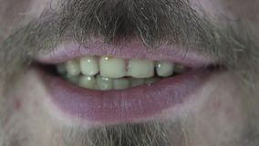 Male mouth with yellow teeth. Concept stock video