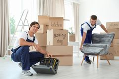 Male movers with instruments and armchair