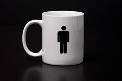 Male Mug. A mug with a male on it isolated on a black background Royalty Free Stock Photo
