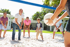 Male Multi Generation Family Playing Volleyball In Garden Stock Photos