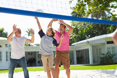 Male Multi Generation Family Playing Volleyball In Garden Stock Photography