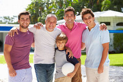 Male Multi Generation Family Playing Volleyball In Garden Royalty Free Stock Photos