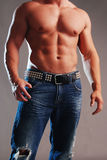 Male muscle in jeans Royalty Free Stock Photo