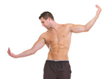 Male with muscular body gracefully posing. Male athlete with muscular body gracefully posing Royalty Free Stock Images