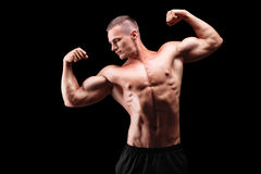 Male muscular bodybuilder posing Stock Photo