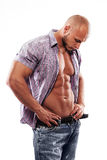 Male muscular model with open shirt. On a white background Royalty Free Stock Images