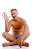 male muscular palm showing sitting Στοκ φωτογραφία με δικαίωμα ελεύθερης χρήσης