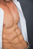 Male muscular torso with six pack abs. Abdominal closeup shot. Bodybuilding concept stock photos