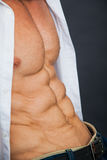Male muscular torso with six pack abs. Abdominal closeup shot. Bodybuilding concept stock photo