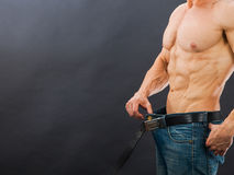 Male muscular torso with six pack abs. Weight loss concept Royalty Free Stock Photos