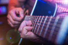 Male Musician with a acoustic Guitar Royalty Free Stock Images