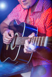Male Musician with a acoustic Guitar Stock Photography