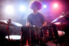 Male musician with drumsticks playing drums Royalty Free Stock Photography