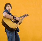 Male musician with guitar stock photo
