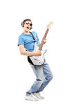 Male musician with headphones playing an electric guitar Stock Photo