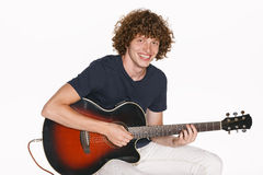 Male musician with his guitar Royalty Free Stock Photos