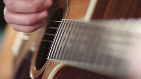 Male musician playing on acoustic guitar. stock footage