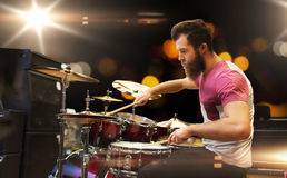 Male musician playing cymbals at music concert. Music, people, musical instruments and entertainment concept - male musician playing cymbals at rock concert Royalty Free Stock Photo