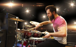 Male musician playing cymbals at music concert. Music, people, musical instruments and entertainment concept - male musician playing cymbals at rock concert Stock Photography