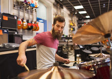 Male musician playing cymbals at music store Royalty Free Stock Photography