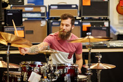 Male musician playing cymbals at music store Stock Image