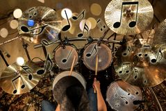 Male musician playing drum kit at concert Stock Images