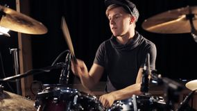 Male musician playing drums and cymbals at concert stock video