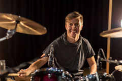 Male musician playing drums and cymbals at concert Stock Photos